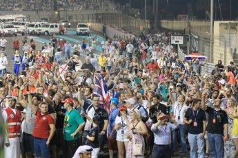 World © Octane Photographic Ltd. Sunday 23rd November 2014. Abu Dhabi Grand Prix - Yas Marina Circuit - Formula 1 Podium. Mercedes AMG Petronas – Fans on the track. Digital Ref: 1173CB1D0903