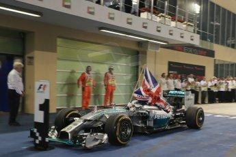 World © Octane Photographic Ltd. Sunday 23rd November 2014. Abu Dhabi Grand Prix - Yas Marina Circuit - Formula 1 Podium. Mercedes AMG Petronas – Lewis Hamilton - Race winner and 2014 World Champion. Digital Ref: 1173LB1D7579