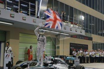 World © Octane Photographic Ltd. Sunday 23rd November 2014. Abu Dhabi Grand Prix - Yas Marina Circuit - Formula 1 Podium. Mercedes AMG Petronas – Lewis Hamilton - Race winner and 2014 World Champion. Digital Ref: 1173LB1D7624