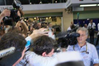 World © Octane Photographic Ltd. Sunday 23rd November 2014. Abu Dhabi Grand Prix - Yas Marina Circuit - Formula 1 Podium. Mercedes AMG Petronas – Lewis Hamilton - Race winner and 2014 World Champion greeting his team and family. Digital Ref: 1173LB1D7694