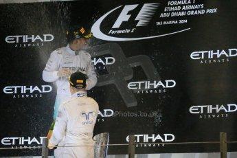 World © Octane Photographic Ltd. Sunday 23rd November 2014. Abu Dhabi Grand Prix - Yas Marina Circuit - Formula 1 Podium. Mercedes AMG Petronas – Lewis Hamilton - Race winner and 2014 World Champion. Digital Ref: 1173LB1DX7614