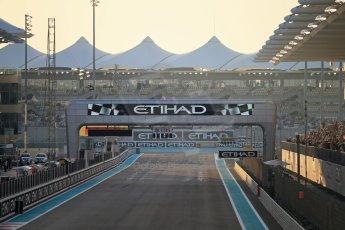 World © Octane Photographic Ltd. Saturday 22nd November 2014. Abu Dhabi Grand Prix - Yas Marina Circuit - Formula 1 Qualifying. 1st corner at Sunset Digital Ref: 1166LB1D0722