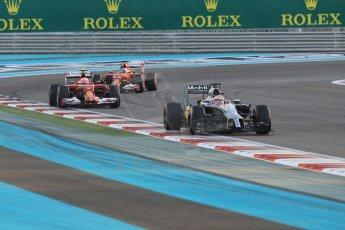 World © Octane Photographic Ltd. Sunday 23rd November 2014. Abu Dhabi Grand Prix - Yas Marina Circuit - Formula 1 Race. McLaren Mercedes MP4/29 - Jenson Button and Scuderia Ferrari F14T – Kimi Raikkonen and Fernando Alonso. Digital Ref: