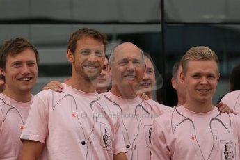 World © Octane Photographic Ltd. Saturday 5th July 2014. British GP, Silverstone, UK. - Formula 1 Paddock. Jenson Button, Kevin Magnussen, Ron Dennis and the McLaren team in their #Pinkforpapa shirts. Digital Ref: 1025LB1D0612