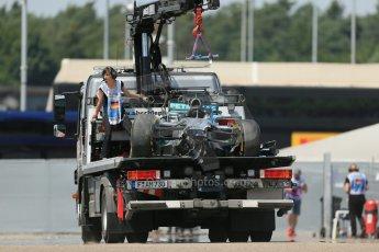 World © Octane Photographic Ltd. Saturday 19th July 2014. German GP, Hockenheim. - Formula 1 Qualifying. Mercedes AMG Petronas F1 W05 Hybrid - Lewis Hamilton's wrecked car being recovered after rear brake failure. Digital Ref: