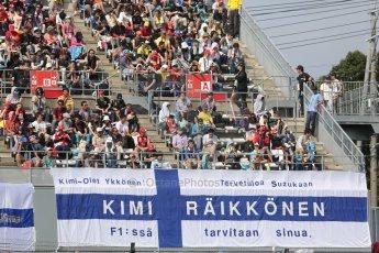 World © Octane Photographic Ltd. Friday 3rd October 2014, Japanese Grand Prix - Suzuka. - Formula 1 Practice 2. Kimi Raikkonen fans flag. Digital Ref: