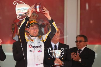World © Octane Photographic Ltd. Friday 23rd May 2014. GP2 Feature Race – Monaco, Monte Carlo. Jolyon Palmer raises his winners trophy - DAMS. Digital Ref : 0963CB7D3106
