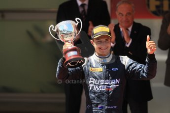 World © Octane Photographic Ltd. Friday 23rd May 2014. GP2 Feature Race – Monaco, Monte Carlo. Mitch Evans raises his 2nd place trophy - RT Russian Time. Digital Ref : 0963LB1D7287