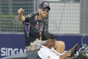 World © Octane Photographic Ltd. Saturday 20th September 2014, Singapore Grand Prix, Marina Bay. Formula 1 Drivers' Parade. Infiniti Red Bull Racing RB10 - Sebastian Vettel. Digital Ref: 1127CB1D0863