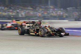 World © Octane Photographic Ltd. Saturday 20th September 2014, Singapore Grand Prix, Marina Bay. - Formula 1 Race outlap. Lotus F1 Team E22 - Romain Grosjean and Marussia F1 Team MR03 – Max Chilton. Digital Ref: 1127CB1D1032