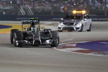 World © Octane Photographic Ltd. Sunday 21st September 2014, Singapore Grand Prix, Marina Bay. - Formula 1 Race. Mercedes AMG Petronas F1 W05 - Nico Rosberg starting from the pitlane ahead of the Medical Car. Digital Ref: 1127CB1D1227