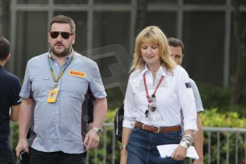 World © Octane Photographic Ltd. Saturday 20th September 2014, Singapore Grand Prix, Marina Bay. - Formula 1 Paddock. Louise Goodman (Singapore GPTV) and Paul Hembery - Pirelli. Digital Ref: 1122CB1D8293