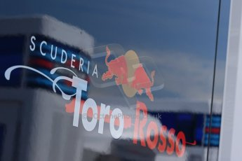 World © Octane Photographic Ltd. Thursday 8th May 2014. Circuit de Catalunya - Spain - Formula 1 Paddock. Scuderia Toro Rosso logo with reflection of Williams Martini Racing logo. Digital Ref: 0922lb1d2846