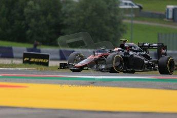 World © Octane Photographic Ltd. McLaren Honda MP4/30 - Jenson Button. Friday 19th June 2015, F1 Austrian GP Practice 1, Red Bull Ring, Spielberg, Austria. Digital Ref: 1304LB1D5261