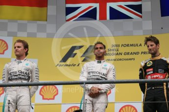 World © Octane Photographic Ltd. Mercedes AMG Petronas F1 W06 Hybrid – Lewis Hamilton (1st), Nico Rosberg (2nd) and Lotus F1 Team E23 Hybrid – Romain Grosjean (3rd). Sunday 23rd August 2015, F1 Belgian GP Podium, Spa-Francorchamps, Belgium. Digital Ref: 1390LB1D2296