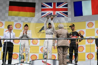 World © Octane Photographic Ltd. Mercedes AMG Petronas F1 W06 Hybrid – Lewis Hamilton (1st), Nico Rosberg (2nd) and Lotus F1 Team E23 Hybrid – Romain Grosjean (3rd). Sunday 23rd August 2015, F1 Belgian GP Podium, Spa-Francorchamps, Belgium. Digital Ref: 1390LB1D2332