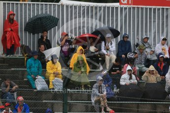 World © Octane Photographic Ltd. Fans with umbrellas. Friday 25th September 2015, F1 Japanese Grand Prix, Practice 2, Suzuka. Digital Ref: