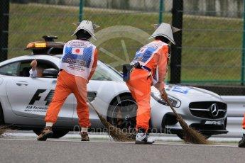 World © Octane Photographic Ltd. Marshals. Saturday 26th September 2015, F1 Japanese Grand Prix, Practice 3, Suzuka. Digital Ref: