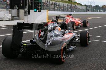 World © Octane Photographic Ltd. Scuderia Ferrari SF15-T– Kimi Raikkonen and McLaren Honda MP4/30 – Fernando Alonso. Saturday 26th September 2015, F1 Japanese Grand Prix, Practice 3, Suzuka. Digital Ref: