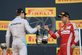 World © Octane Photographic Ltd. Mercedes AMG Petronas F1 W06 Hybrid – Nico Rosberg (2nd) and Scuderia Ferrari SF15-T– Sebastian Vettel (3rd). Sunday 27th September 2015, F1 Japanese Grand Prix, Podium, Suzuka. Digital Ref: