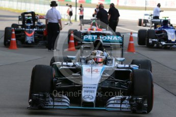 World © Octane Photographic Ltd. Mercedes AMG Petronas F1 W06 Hybrid – Lewis Hamilton (1st). Sunday 27th September 2015, F1 Japanese Grand Prix, Parc Ferme, Suzuka. Digital Ref: