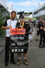 World © Octane Photographic Ltd. McLaren Honda MP4/30 - Jenson Button and fan in the paddock. Saturday 26th September 2015, F1 Japanese Grand Prix, Paddock, Suzuka. Digital Ref: 1445CB5D1828