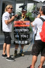 World © Octane Photographic Ltd. Fan being interviewed in the paddock. Saturday 26th September 2015, F1 Japanese Grand Prix, Paddock, Suzuka. Digital Ref: 1445CB5D1846
