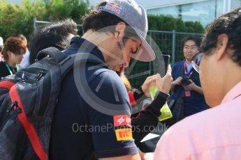World © Octane Photographic Ltd. Scuderia Toro Rosso STR10 – Carlos Sainz Jnr sign autographs for the fans. Saturday 26th September 2015, F1 Japanese Grand Prix, Paddock, Suzuka. Digital Ref: 1445CB7D6280