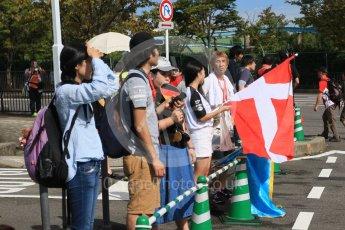 World © Octane Photographic Ltd. The Japanese fans waiting at the paddock entrance. Saturday 26th September 2015, F1 Japanese Grand Prix, Paddock, Suzuka. Digital Ref: 1445CB7D6348