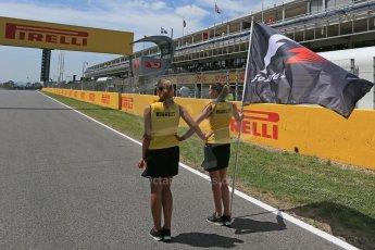 World © Octane Photographic Ltd. Grid girls with F1 Flag. Sunday 10th May 2015, F1 Spanish GP Formula 1 Grid, Circuit de Barcelona-Catalunya, Spain. Digital Ref: 1264LB1D0131