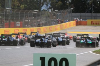 World © Octane Photographic Ltd. Saturday 9th May 2015. The pack safely bunches into turn 1. GP2 Race 1 – Circuit de Barcelona–Catalunya. Spain. Digital Ref: