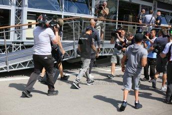 World © Octane Photographic Ltd. Mercedes AMG Petronas F1 W06 Hybrid – Lewis Hamilton enters with the paddock with his brother Nic Hamilton. Thursday 7th May 2015, F1 Spanish GP Paddock, Circuit de Barcelona-Catalunya, Spain. Digital Ref: 1244LB5D0443