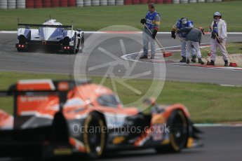 World © Octane Photographic Ltd. FIA World Endurance Championship (WEC), 6 Hours of Nurburgring , Germany - Practice 3, Saturday 29th August 2015. Marshals clearing gravel from the track. Digital Ref : 1395LB1D5355