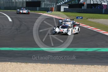 World © Octane Photographic Ltd. FIA World Endurance Championship (WEC), 6 Hours of Nurburgring , Germany - Race, Sunday 30th August 2015. Porsche Team – Porsche 919 Hybrid - LMP1 - Timo Bernhard, Mark Webber and Brendon Hartley, Audi Sport Team Joest- Audi R18 e-tron Quatrro - LMP1 - Oliver Jarvis, Lucas di Grassi and Loic Duval and Andre Lotterer, Benoit Treluyer and Marcel Fassler. Digital Ref : 1398LB1D6502
