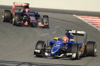 World © Octane Photographic Ltd. Sauber F1 Team C34-Ferrari – Felipe Nasr and Scuderia Toro Rosso STR10 – Max Verstappen. Thursday 19th February 2015, F1 Winter testing, Circuit de Catalunya, Barcelona, Spain, Day 1. Digital Ref : 1187CB7B0155