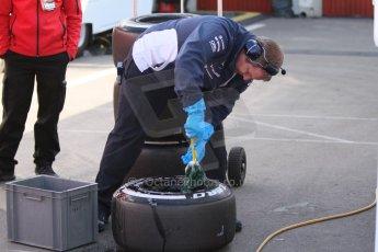 World © Octane Photographic Ltd. Williams Martini Racing - Mechanic cleaning a wheel. Thursday 19th February 2015, F1 Winter testing, Circuit de Catalunya, Barcelona, Spain, Day 1. Digital Ref:1187CB7L1430