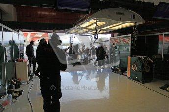 World © Octane Photographic 2011. Formula 1 testing Wednesday 9th March 2011 Circuit de Catalunya. Lotus garage. Lotus T124 - Jarno Trulli. Digital ref : 0020CB5D5722