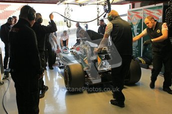 World © Octane Photographic 2011. Formula 1 testing Wednesday 9th March 2011 Circuit de Catalunya. Lotus garage. Lotus T124 - Jarno Trulli. Digital ref : 0020CB5D5725