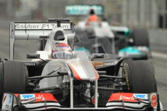 World © Octane Photographic 2011. Formula 1 testing Friday 11th March 2011 Circuit de Catalunya. Sauber C30 - Kamui Kobayashi. Mercedes MGP W02 - Michael Schumacher. Digital ref : 0022CB1D3855