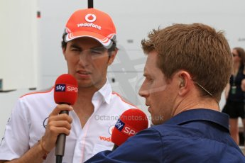 World © Octane Photographic Ltd. F1 Spanish GP Thursday 9th May 2013. Paddock and pitlane. Vodafone McLaren Mercedes - Sergio Perez being interviewed by Anthony Davidson of Sky Sports F1. Digital Ref : 0654cb7d8734