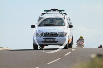 © Octane Photographic Ltd 2011. NW200 Thursday 19th May 2011. Medical team on the way to Stuart Easton's accident. Digital Ref : LW7D1490