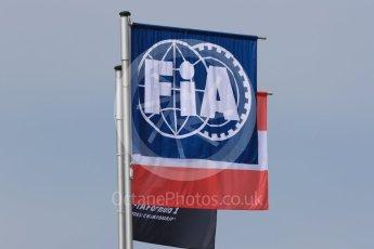 World © Octane Photographic Ltd. FIA Formula 1 flag with the Austrian flag. Thursday 30th June 2016, F1 Austrian GP Pit Lane, Red Bull Ring, Spielberg, Austria. Digital Ref : 1594LB1D0210