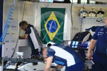 World © Octane Photographic Ltd. Williams Martini Racing, Williams Mercedes FW38 – Felipe Massa' s car being worked on with Brazilian flag in the background. Thursday 24th November 2016, F1 Abu Dhabi GP - Pitlane, Yas Marina circuit, Abu Dhabi. Digital Ref :