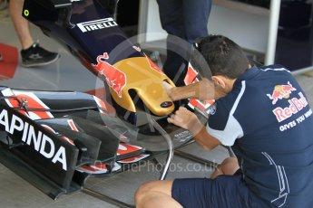 World © Octane Photographic Ltd. Scuderia Toro Rosso STR11 – Front Wing adjustments. Friday 25th November 2016, F1 Abu Dhabi GP - Practice 1, Yas Marina circuit, Abu Dhabi. Digital Ref :