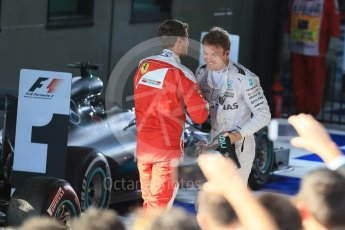 World © Octane Photographic Ltd. Scuderia Ferrari – Sebastian Vettel and Mercedes AMG Petronas – Nico Rosberg. Sunday 20th March 2016, F1 Australian GP Race – Parc Ferme, Melbourne, Albert Park, Australia. Digital Ref : 1525LB1D7626