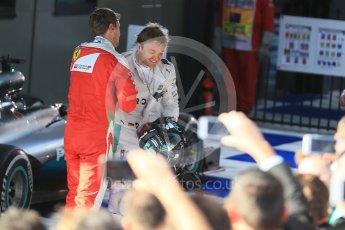 World © Octane Photographic Ltd. Scuderia Ferrari – Sebastian Vettel and Mercedes AMG Petronas – Nico Rosberg. Sunday 20th March 2016, F1 Australian GP Race – Parc Ferme, Melbourne, Albert Park, Australia. Digital Ref : 1525LB1D7631