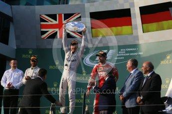World © Octane Photographic Ltd. Mercedes AMG Petronas – Nico Rosberg, Lewis Hamilton and Scuderia Ferrari – Sebastian Vettel. Sunday 20th March 2016, F1 Australian GP Race - Podium, Melbourne, Albert Park, Australia. Digital Ref : 1525LB1D7831