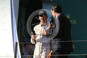 World © Octane Photographic Ltd. Mercedes AMG Petronas – Lewis Hamilton and Mark Webber. Sunday 20th March 2016, F1 Australian GP Race - Podium, Melbourne, Albert Park, Australia. Digital Ref : 1525LB1D8245