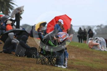 World © Octane Photographic Ltd. Fans watch in the rain. Friday 18th March 2016, F1 Australian GP Practice 1, Melbourne, Albert Park, Australia. Digital Ref : 1516LB5D1250