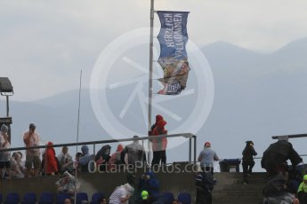 World © Octane Photographic Ltd. Fans in the grandstands during the thunderstorm. Friday 1st July 2016, F1 Austrian GP Practice 2, Red Bull Ring, Spielberg, Austria. Digital Ref : 1600CB1D2495